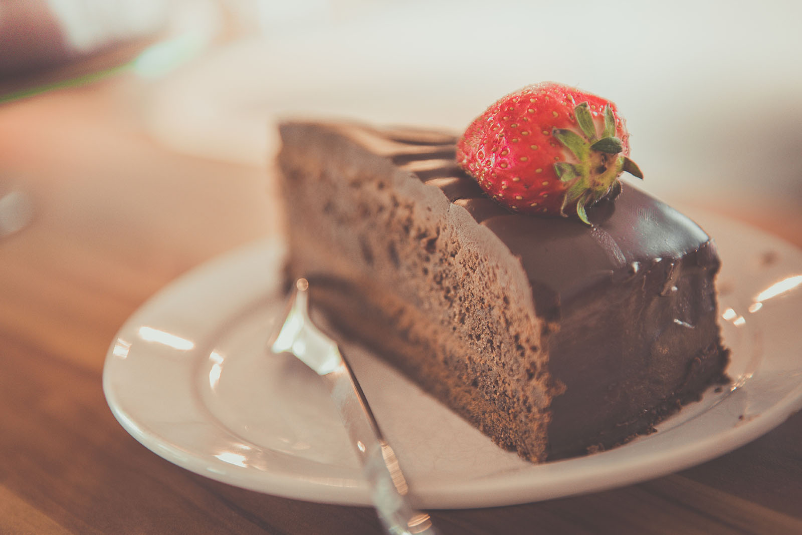 Chocolate cake with strawberry on top.