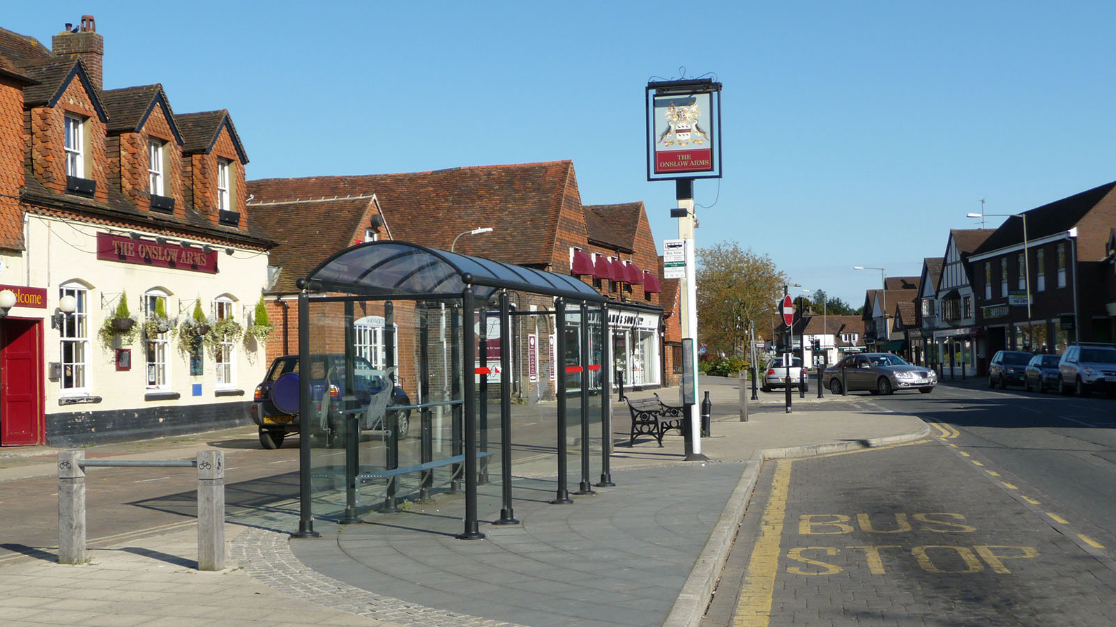 "A bus stop along High Street, Cranleigh, named ""50 Pence, High Street""."