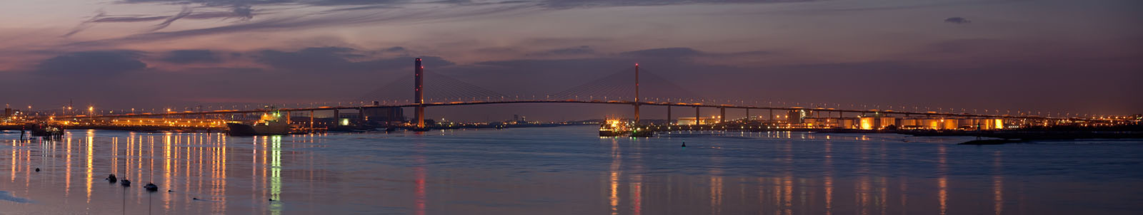 A panoramic view of the Queen Elizabeth II Bridge in Dartford, England, as viewed from Greenhithe in Kent.