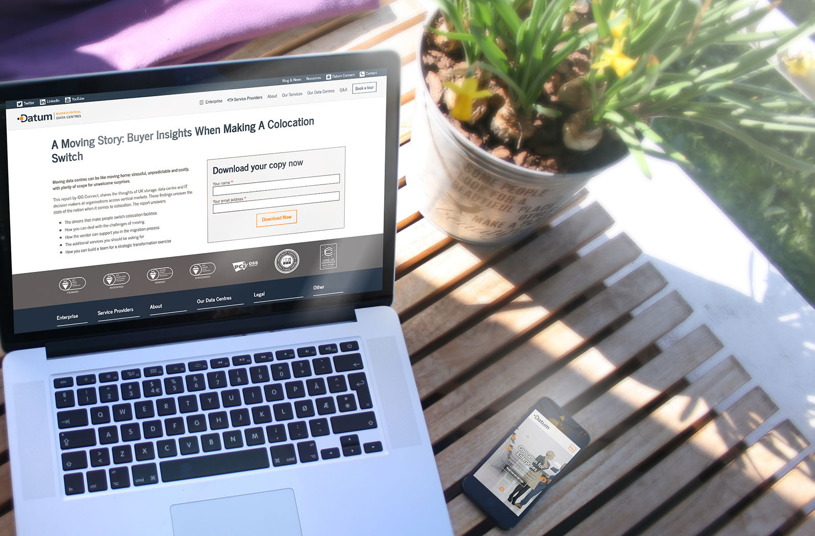 An example of a custom landing page shown on an Apple MacBook outside on a bench next to a flower pot.