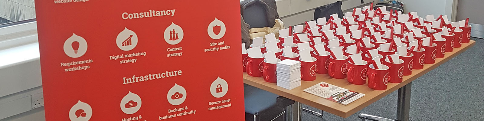 Real Life Digital merchandise stand at DrupalCamp London 2017.