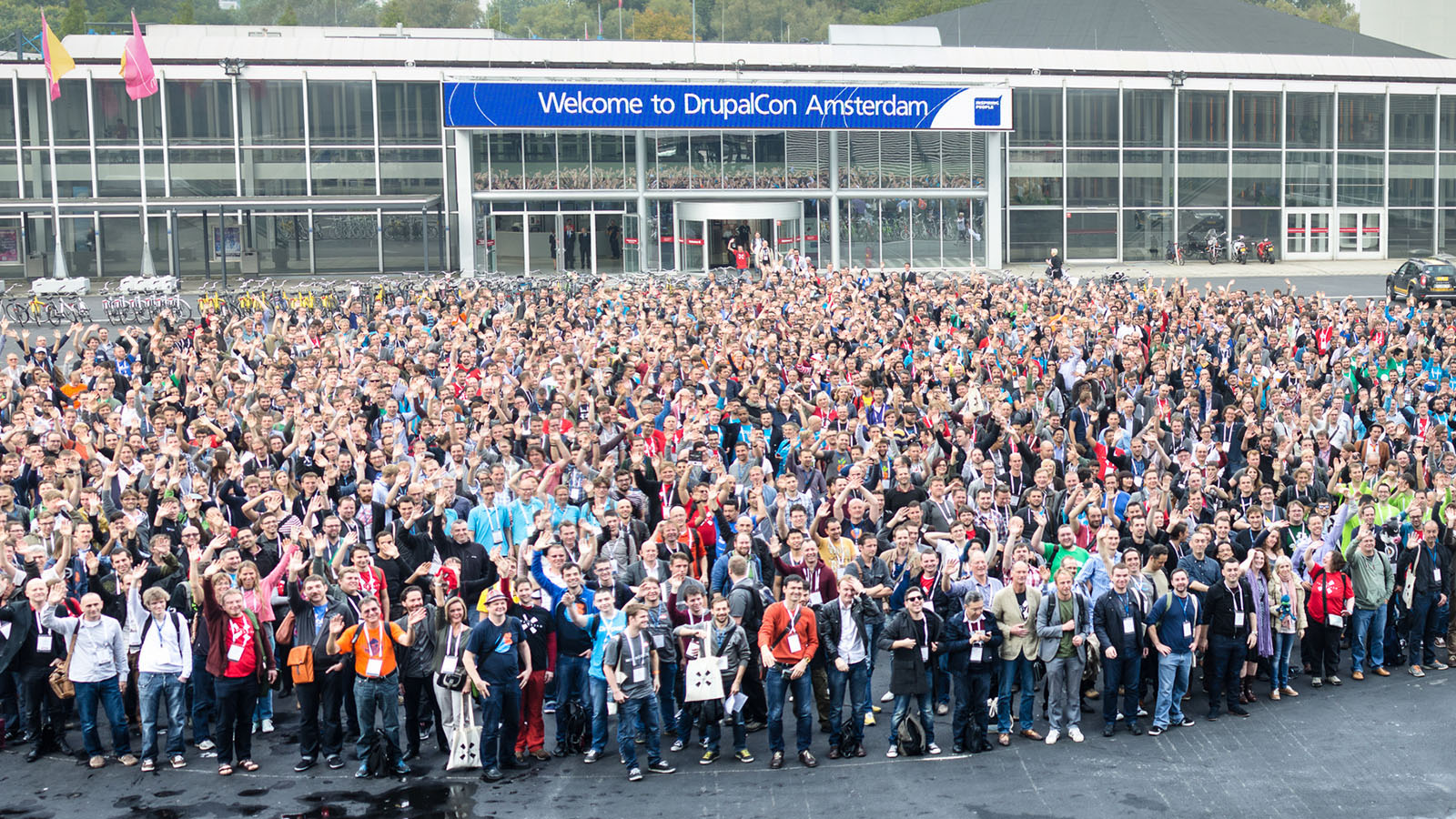 Thousands of drupal developers and users pose for a photograph outside of the RAI centre in Amsterdam for the 2014 DrupalCon.