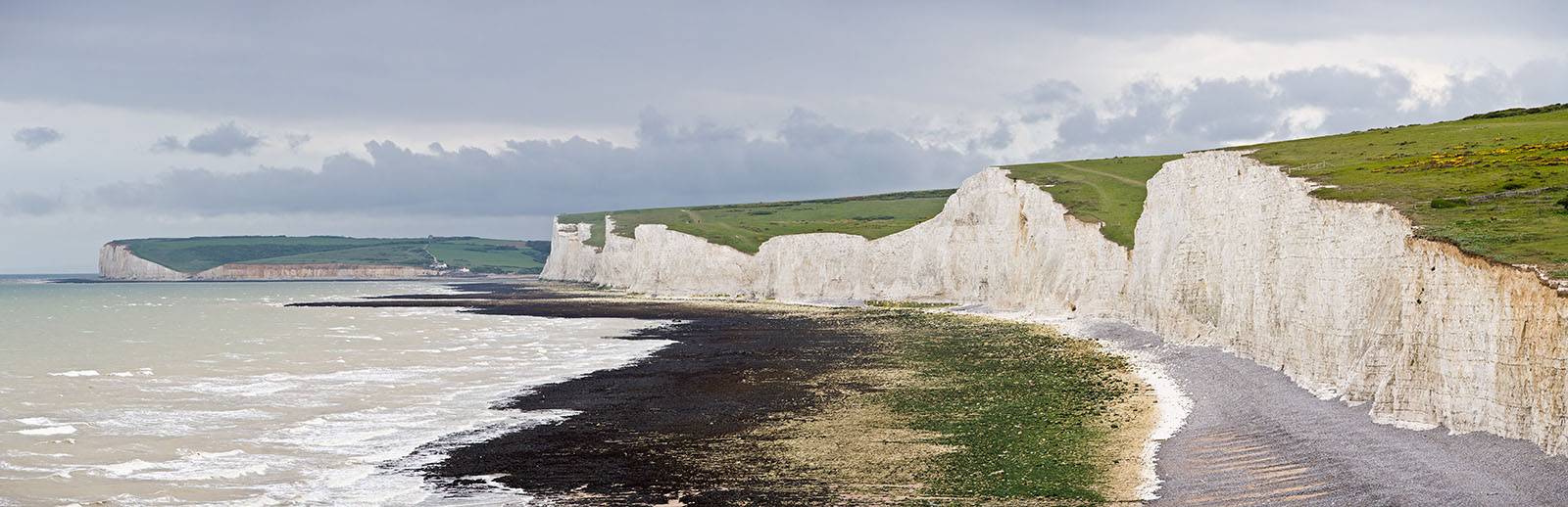 The Seven Sisters, a series of seven chalk cliff peaks along the East Sussex coast in England. Seaford head in the background is on the other side of the River Cuckmere and not part of the Seven Sisters.
