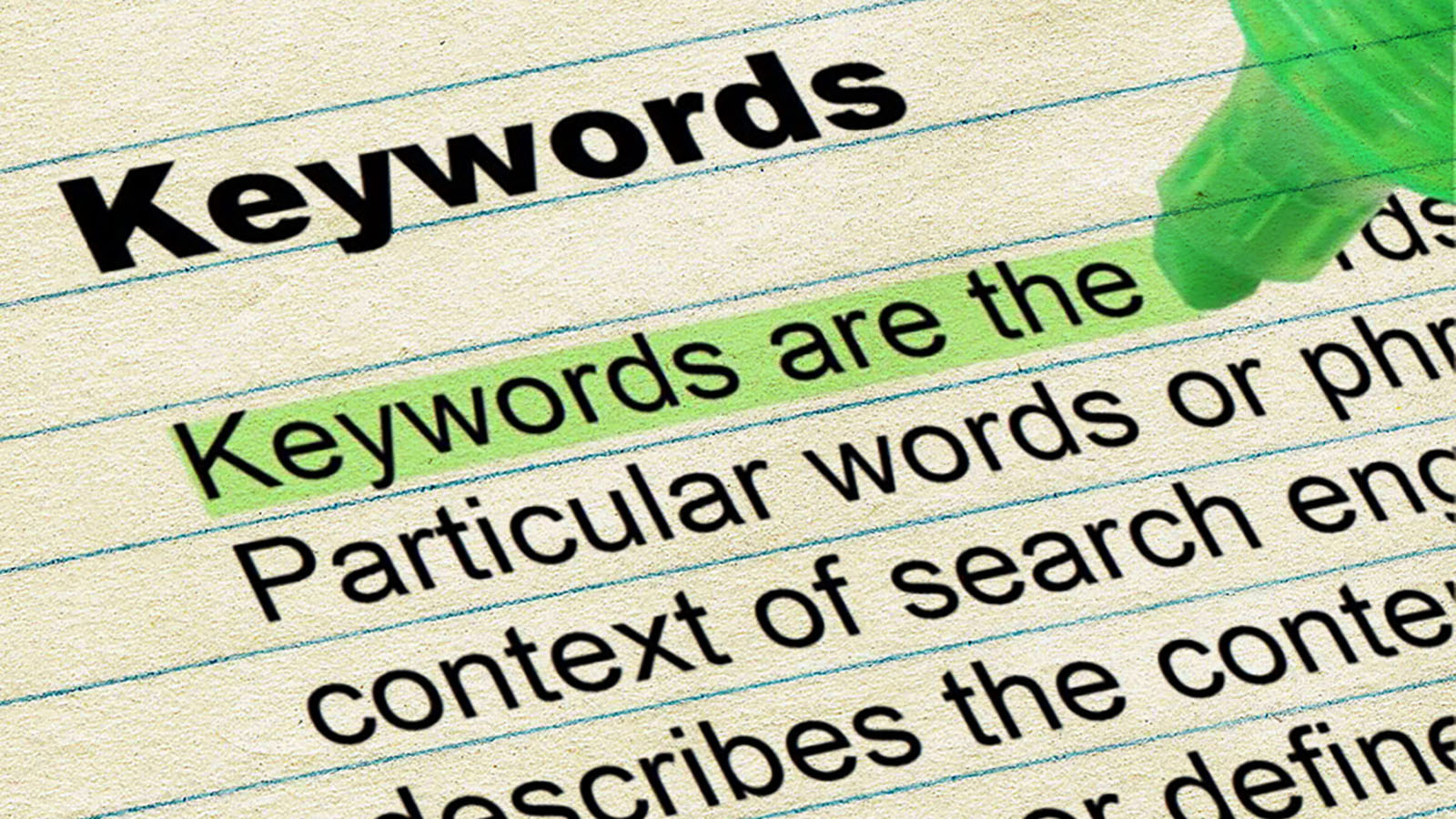 A piece of paper with the title Keywords and then some text underneath, an area of which is highlighted which reads: 'Keywords are the'.