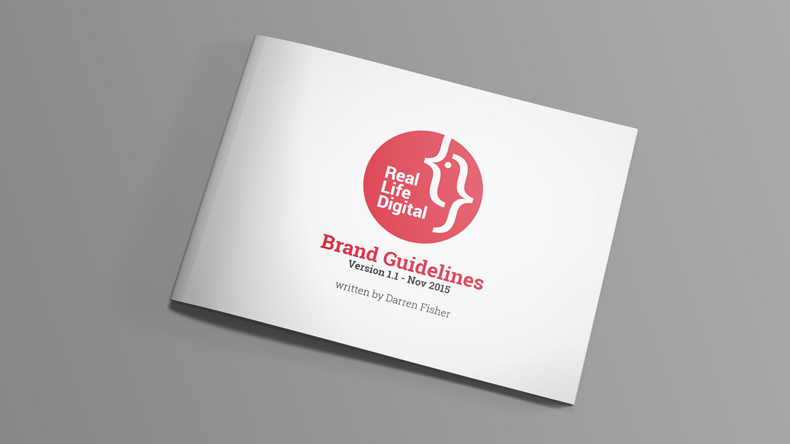 A closed copy of Real Life Digital's branding document showing the cover.