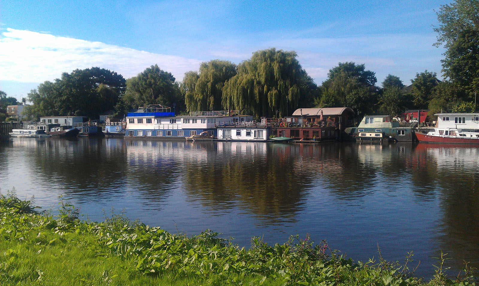 Houseboats on Thames river in Richmond - Surrey - UK.