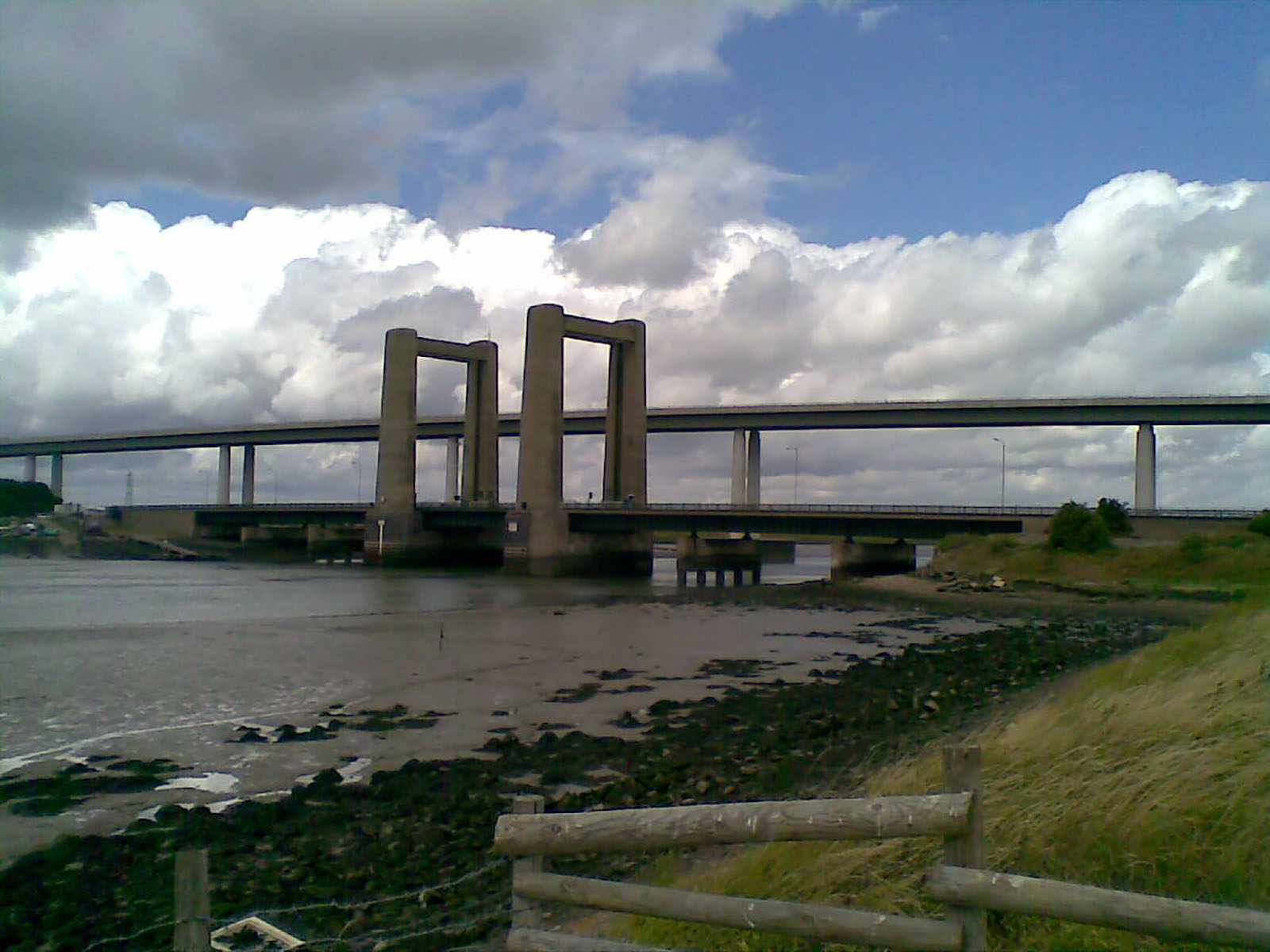 The Kingsferry Bridge, looking West from the Isle of Sheppey, with the more modern Sheppey Crossing behind.