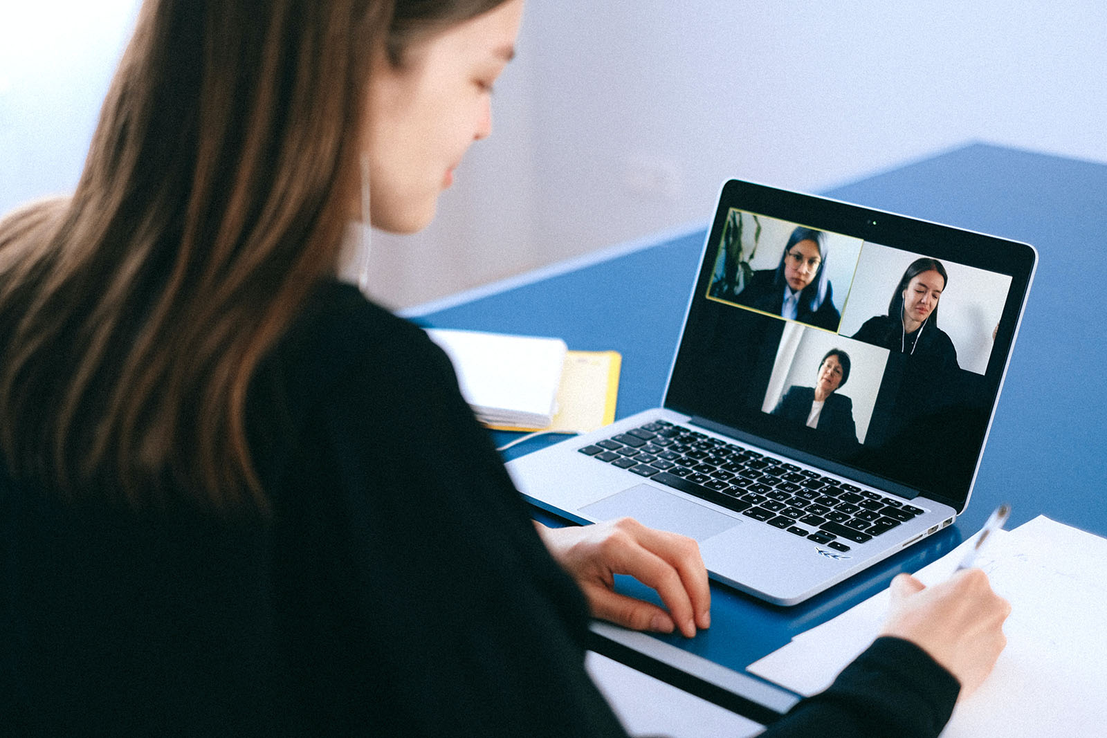 A video conference call taking place on a laptop.