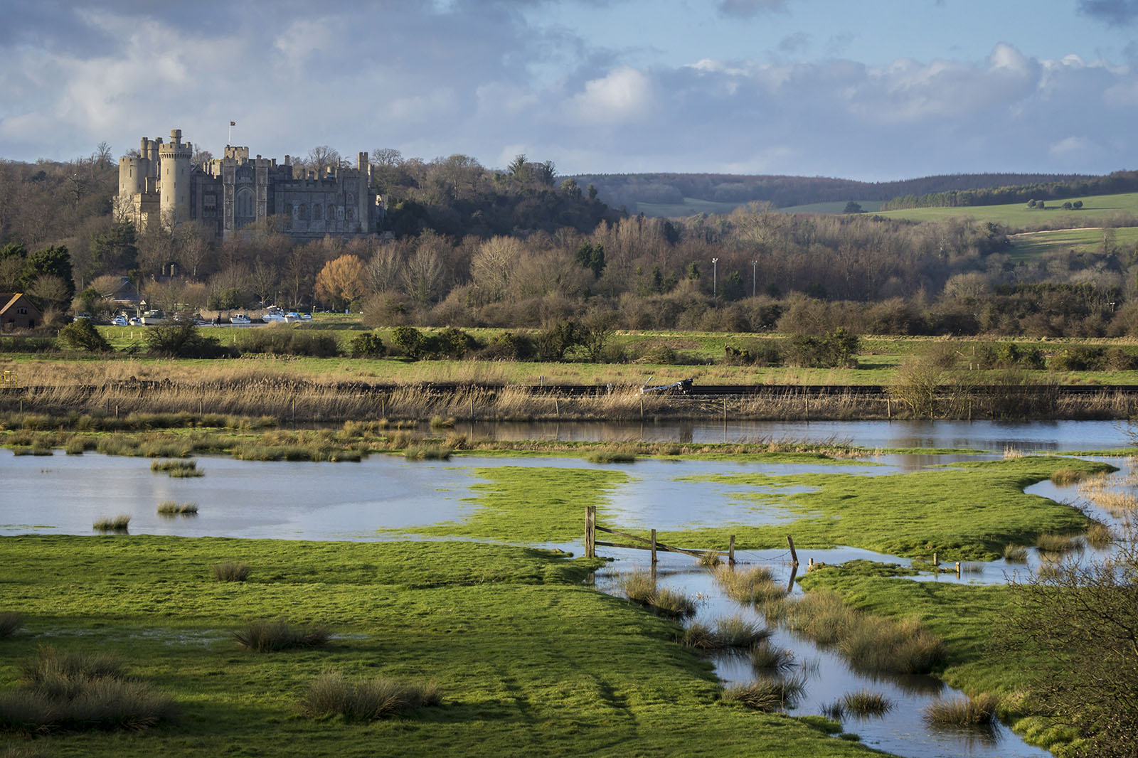 Arundel Castle, West Sussex, England. The river has flooded the fields.