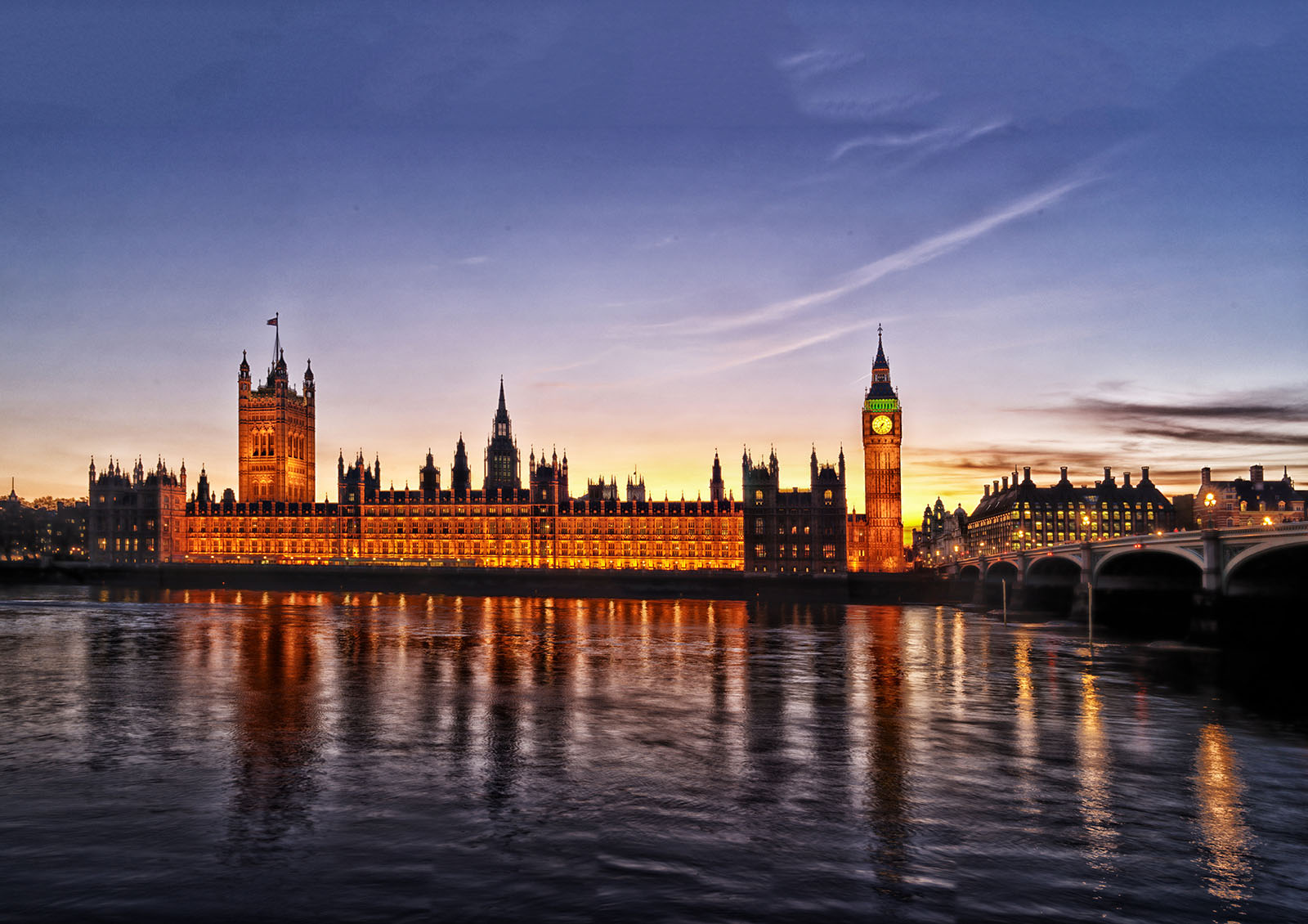 Westminster Palace from the opposite side of the Thames at dusk.